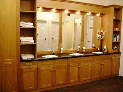 Commercial Bathroom With Oak Units