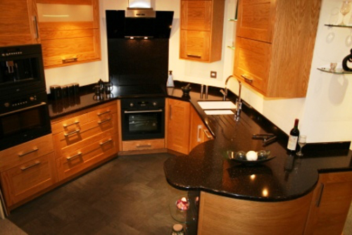 Kitchen With High Gloss Staron Worksurfaces