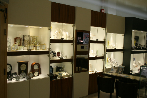 Pointing-And Walnut Display Cabinets